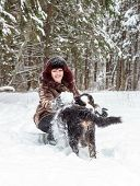 image of dog ears  - Happy girl smiling and holding a mountain dog behind the ears - JPG