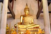Big and old sitting golden Buddha in Ayutthaya province, Thailand.