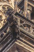 image of gargoyles  - Gargoyle Statue on Saint Vitus Cathedral in Prague Castle Hradcany Retro toned Image - JPG
