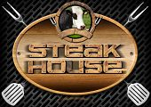 pic of oval  - Oval wooden sign with text Steak House head of cow spatulas and forks on a dark metallic grill - JPG