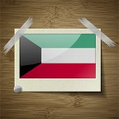 stock photo of kuwait  - Flags of Kuwait at frame on wooden texture - JPG