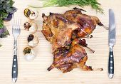 pic of quail  - Roasted Quail with rosemary and spices on the wood background - JPG
