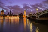 image of westminster bridge  - Houses of Parliament from across the River Thames at dusk - JPG