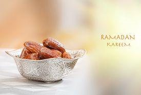 stock photo of bismillah  - Beautiful bowl full of date fruits symbolizing Ramadan - JPG