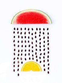 stock photo of rainy weather  - weather concept watermelon and orange shape of rainy season - JPG