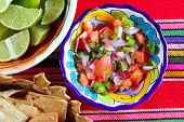 stock photo of poblano  - Pico de gallo tomato and chili Mexican sauces over  serape tablecloth - JPG