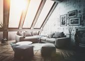 Sunny rooftop apartment interior with large vertical windows, sofa, picture frames and herringbone s poster
