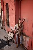stock photo of sherwani  - Young Caucasian bassoon musician in traditional Indian attire - JPG