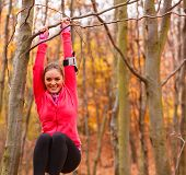 Young Sporty Girl Doing Exercises In Forest. poster