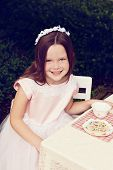 stock photo of tea party  - A beautiful little girl having a tea party - JPG