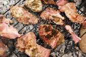 Pork chops roasting on a barbecue