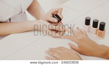 poster of Drawing Of Red Varnish On Beautiful Natural Nails. Manicure In Beauty Salon. Spa Treatment. Young Wo