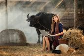 Portrait Of A Beautiful Rural Woman,rural Woman Playing Computer Notebook On Her Farm Background In  poster