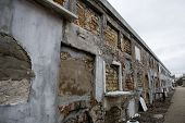 stock photo of burial-vault  - Above ground burial vaults in an historic New Orleans cemetery wide angle shot - JPG