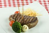 pic of chateaubriand  - delicious Tenderloin steak with red wine on a table - JPG