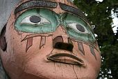 foto of tlingit  - Face on Tlingit Alaska Native carved cedar totem pole - JPG