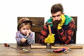 Father And Son In Workshop. Repair Concept. Repair Tools. Instruments. Childrens Creativity. Bored  poster