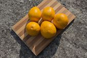 Orange Fruits On A Wooden Board. Fresh Citrus Fruits Background. Bunch Of Forange Fruit. Citrus Frui poster