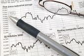 picture of bifocals  - Image of stock market reports with pen and glasses - JPG