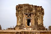 Ancient Khmer Temple In Angkor Wat Complex, Cambodia. Morning Dew In Phnom Bakheng Temple Tower. Bud poster