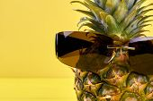 Pineapple With Sunglasses And Copy Space. Close Up Fresh Exotic Pineapple Wearing Male Vintage Sungl poster