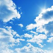 stock photo of clouds  - Blue sky with clouds and sun - JPG