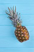 Healthy Pineapple On Color Wooden Surface. Ripe Ananas On Blue Wooden Background, Top View. poster