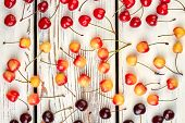 Ripe Cherries Background. Collection Of Juicy Cherries With Stalks On Wooden Background. Background  poster