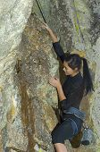 Pretty Young Woman Rock Climbing