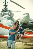Travelling Concept. Family At Retro Planes Parked On Ground, Travelling. Child With Mother And Fathe poster