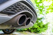 Close Up Of A Car Dual Exhaust Pipe. Double Exhaust Pipes Of A Modern Sports Car. Car Exterior Detai poster