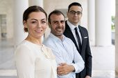 Corporate Portrait Of Pretty Smiling Business Lady With Coworkers. Pretty Smiling Head Of Business C poster