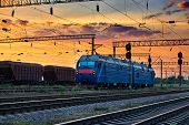 trains and wagons, railroad infrastructure, beautiful sunset and colorful sky, transportation and in poster