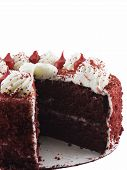 picture of red velvet cake  - Red velvet cake with a slice missing isolated on a white background - JPG