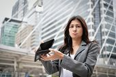 Concept Of Unemployed. Asian Businesswoman Is Opening Empty Wallet. Young Business Woman Is Stressed poster