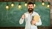 Teacher In Eyeglasses Holds Book And Mug Of Coffee Or Tea. Coffee Break Concept. Man With Beard On H poster