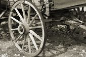 picture of covered wagon  - old wagon wheel close up in sepia - JPG
