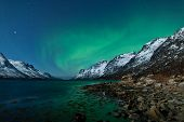 Northern lights (Aurora borealis) between fjords