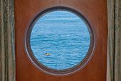 Ocean Kayak Seen Through Cruise Ship Porthole