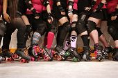 picture of roller-derby  - The roller skates and legs of a female Roller Derby team - JPG