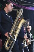 Koen Schouten Plays Baritone Sax With Band Members