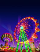 stock photo of centrifuge  - theme park motor rides game in evening view isolated on night view blue purple sky background - JPG