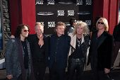 HOLLYWOOD, CA - JUNE 08: Def Leppard arrive at the 'Rock of Ages' Los Angeles premiere at Grauman's Chinese Theatre on June 8, 2012 in Hollywood, California.