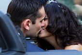 Happy Newlyweds Kissing In Cabrio