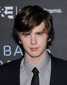 LOS ANGELES - MAR 12:  Freddie Highmore arrives to the A&E Network Premiere of