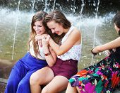 Beautiful Girls Having Fun With A Fountain.