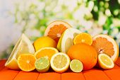 picture of pamelo  - Lots ripe citrus on wooden table on natural background - JPG