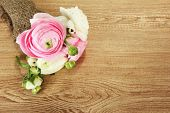 Ranunculus (persian buttercups) on wooden background