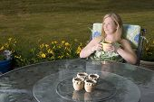 Woman On Patio With Coffee