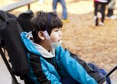 disabled boy in wheelchair on playground